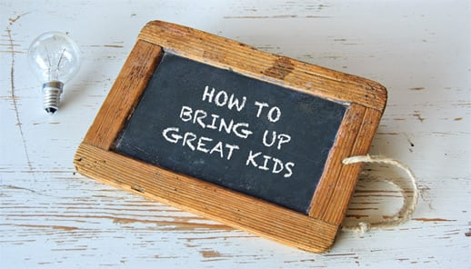 Chalkboard with How To Bring Up Great Kids written on it