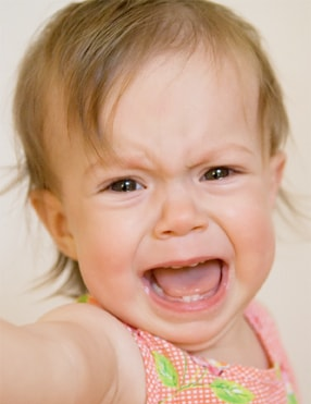 Photo of a baby girl crying